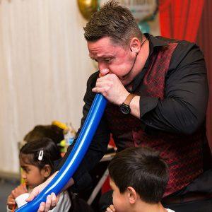 magic martin blowing a balloon