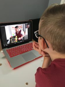 child watching an online magic show