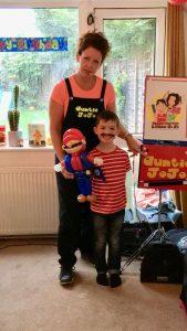 auntie jojo and boy with mario balloon model