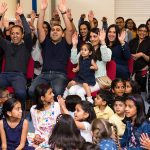 childrens party audience waving