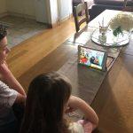 children watching an online magic show zoom