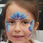 girl with fairy face paint
