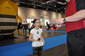 magic martin wowing a child at trade show in london