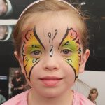 girl with butterfly face paint