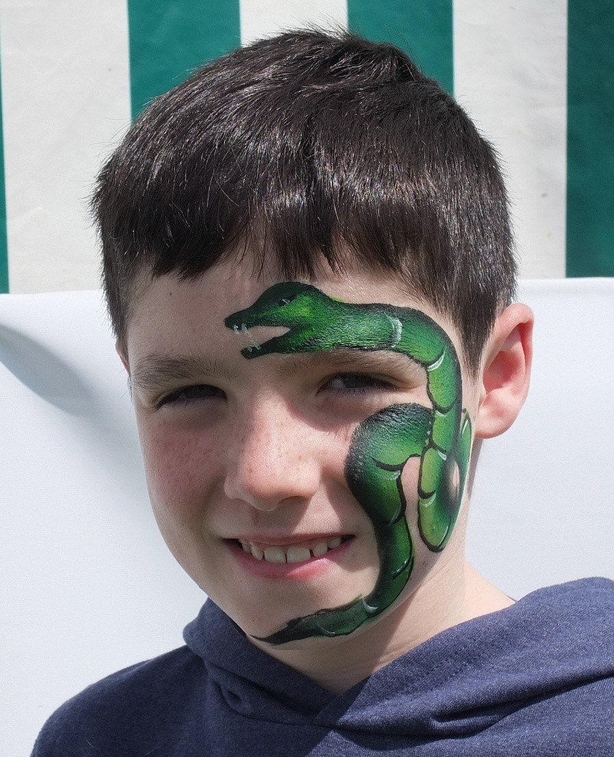 boy with snake face paint