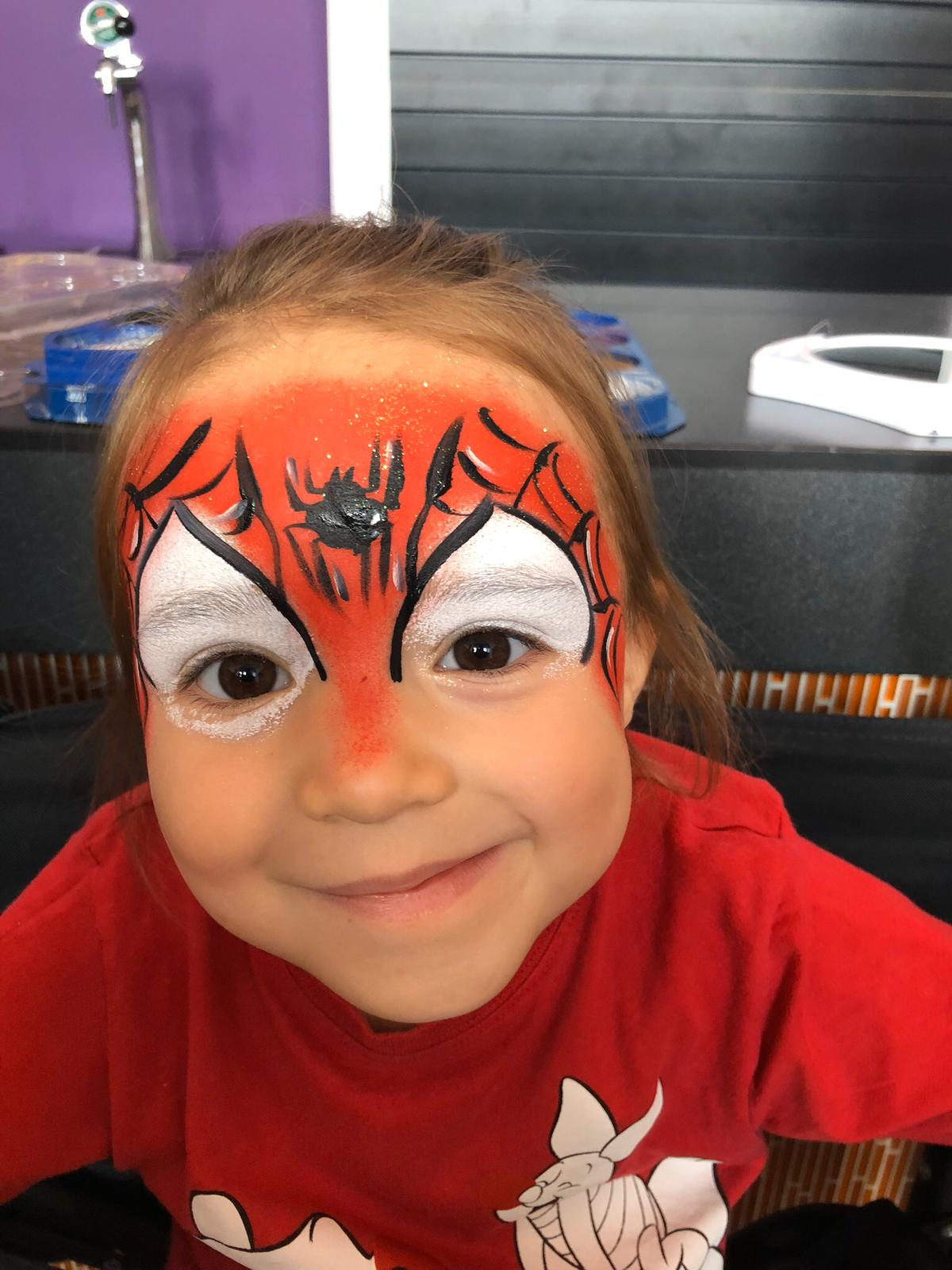 girl with spiderman face paint